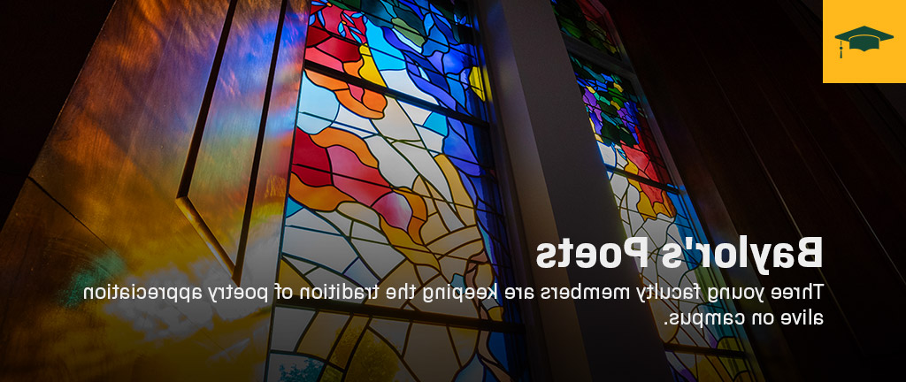 A stained glass window with light coming through.